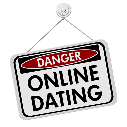 A red, white and black sign with the words Online Dating isolated on a white background, Dangers of Online Dating